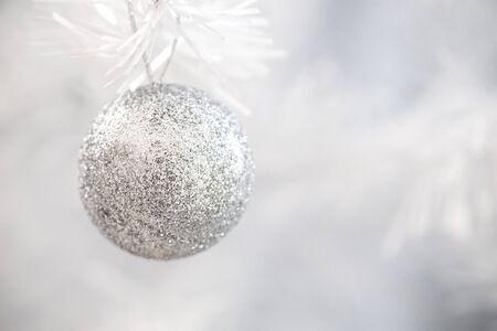glitter ball: silver glitter ball hang on white christmas tree Stock Photo
