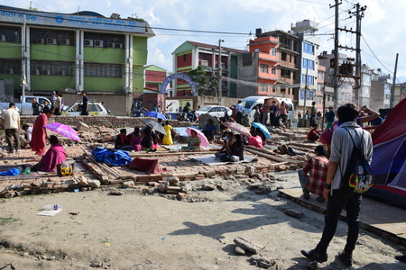 richter: Kathmandu Nepal  May 12 2015 : People stay on an open ground after earthquake disaster
