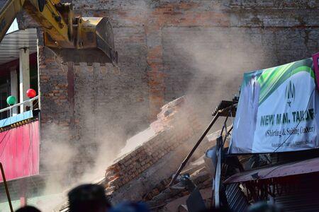 debris: Kathmandu Nepal  May 12 2015 :Dozer restore debris building after earthquake disaster Editorial