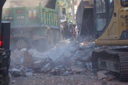 richter: Kathmandu Napal  May 12 2015 :Dozer restore debris building after earthquake disaster