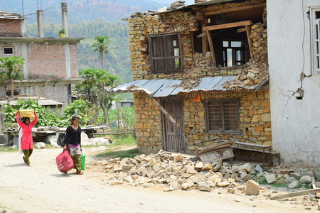 bazar: Sipaghat bazar Kavreplanchok district Nepal  May 8 2015 :Women walk in collapsed building after earthquake disaster
