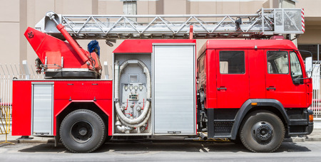Fire truck parked along the road. Stock Photo