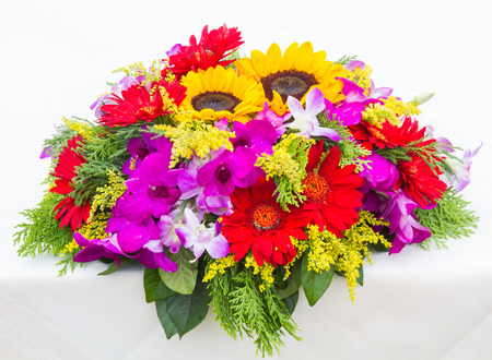 Red Gerbera flowers and Sunflowers, beautiful bouquet of colorful flower on white table