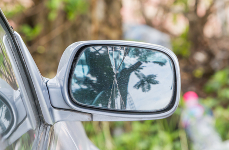 Close up of damaged right rearview mirror on a car. Standard-Bild