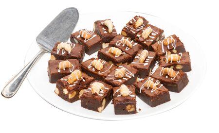 Brownie dessert on a white plate, on white background. Standard-Bild - 144221392