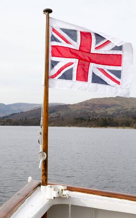 British flag on a pole at the front of the boat on Lake Windermere