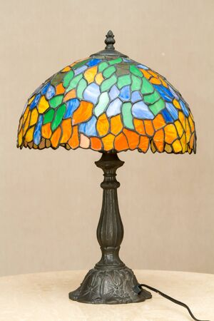 Multi color glass lamp on table.