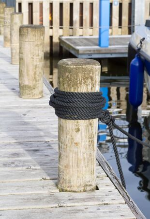 Rope knot on Pillar wooden at pier windermere England.
