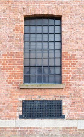 Window and Ventilator on brick wall background.