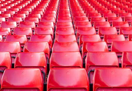 Empty seats red at stadium.