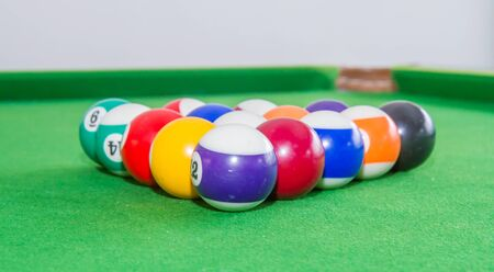 Snooker balls on green table.