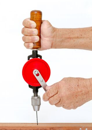 close up, Right hand hold and left hand spin hand drill for drilling wooden on white background. Standard-Bild - 147353673