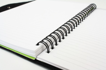 blank notebook on white paper photo