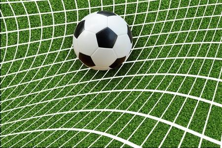 Goal  a soccer ball in a net   photo