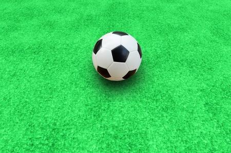 soccer ball on start kick of game photo