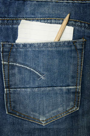Jeans textile pocket with a paper note without the text, looking from it  photo