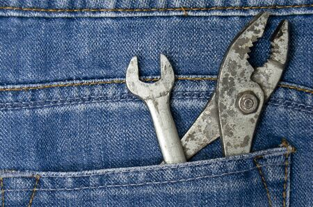 Several tools on a denim workers pocket  photo