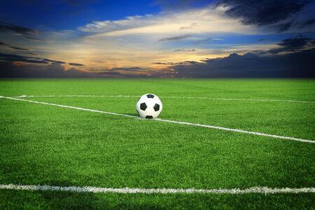 ballsport: soccer ball on soccer field with blue sky