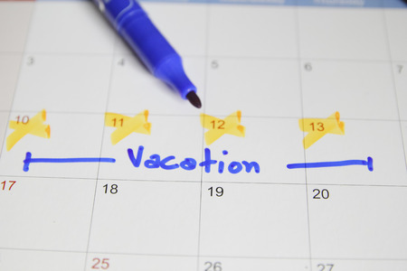 Vacation plan written on calendar Stockfoto
