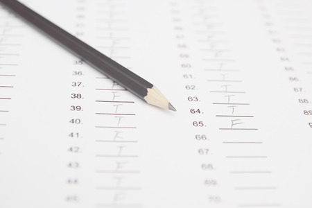 standardized: Standardized test form with answers and a pencil, focus on anser sheet