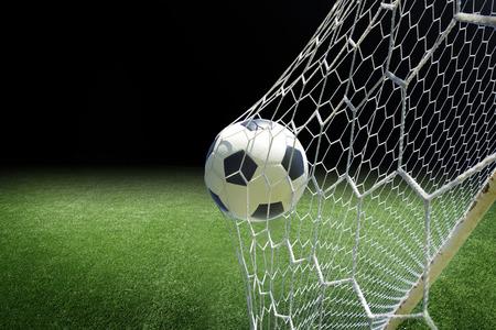 soccer ball in goal Foto de archivo