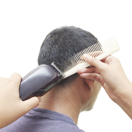 barber: Barber cutting hair with clipper Stock Photo