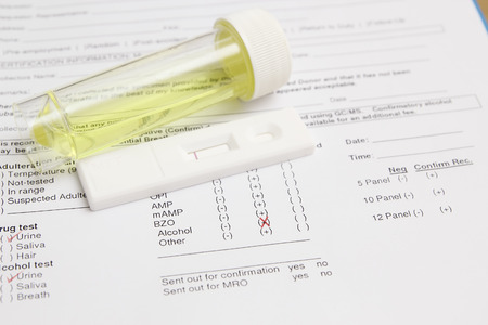 Drug test blank form with test kit and urine,focus on paper Stockfoto