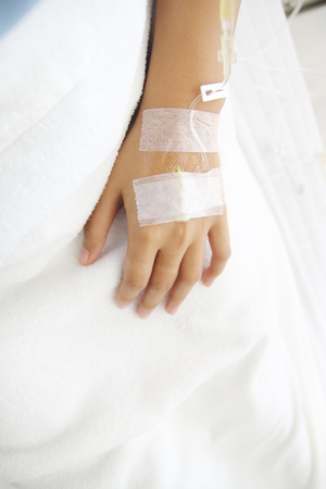 surgical oncology: Close up saline IV drip for patient and Infusion pump in hospital. Stock Photo