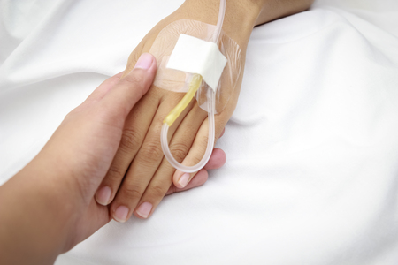 iv: patient in hospital with saline intravenous (iv)