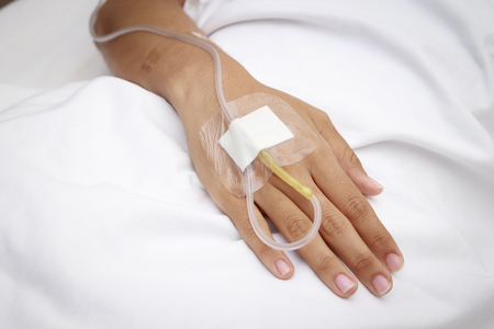 surgical oncology: patient in hospital with saline intravenous (iv)