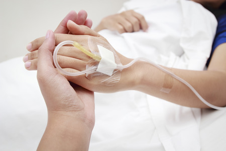 hospital patient: patient in hospital with saline intravenous (iv)