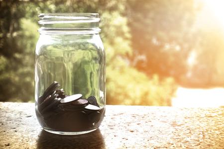 フィルター効果のレトロなビンテージ スタイル ガラスのお金 写真素材