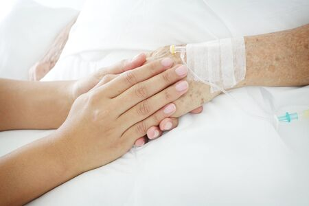 hands holding patient's hand for encouragement and empathy. 写真素材 - 98754464