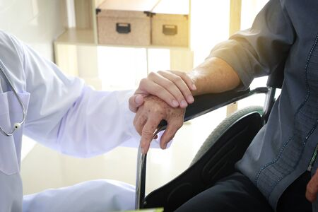 hands holding patients hand for encouragement and empathy.