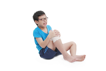 Young boy having knee pain