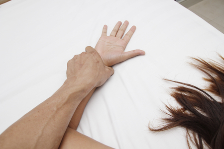 A hairy man's hand holding a woman hand for rape and abuse concept