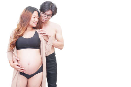 Pregnancy woman with her husband on white background