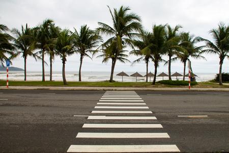 seafront: ?rosswalk across the street on the seafront in Danang, Vietnam