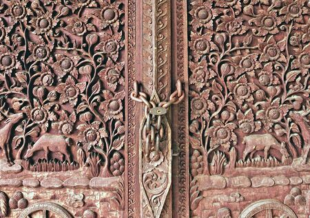 The Carving wood of door at temple Stock Photo - 9442708