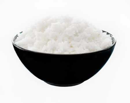 cereal bowl: Rice in a bowl on a white background  Stock Photo