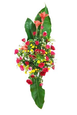Beautiful bouquet of fresh vibrant gerbera flowers arranged in a green leaf photo