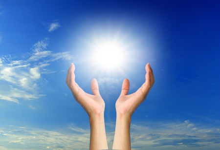 hand sun and blue sky with copyspace