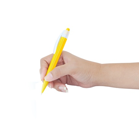 Female hand with yellow pen over white background  photo