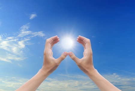 hand sun and blue sky with copyspace Stock Photo - 10523524
