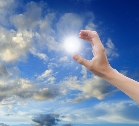 hand sun and blue sky with copyspace Stock Photo - 10523521