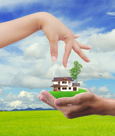 concept of buying house property with blue sky background  photo