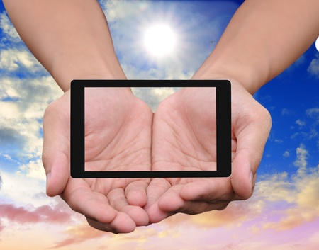 Hand to hold card, mobile phone, tablet PC on blue sky photo