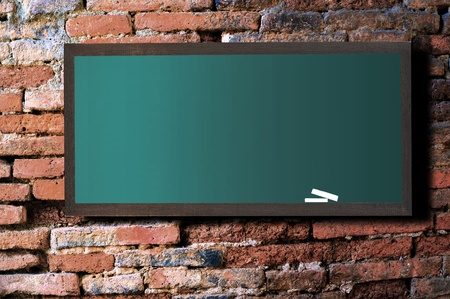 Green board on old wall Brick mortar background  Stock Photo - 11108775