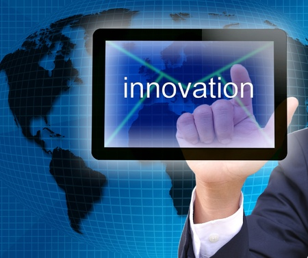 idea generation: businessman hand pressing innovation button on tablet pc  Stock Photo