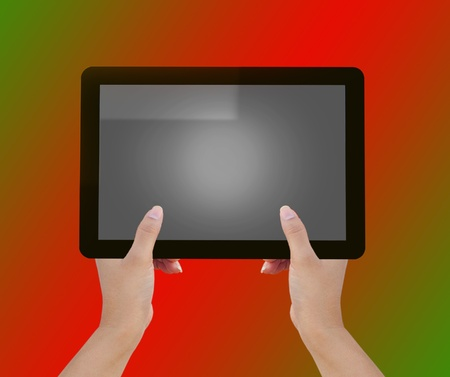 Hand holding tablet computer photo